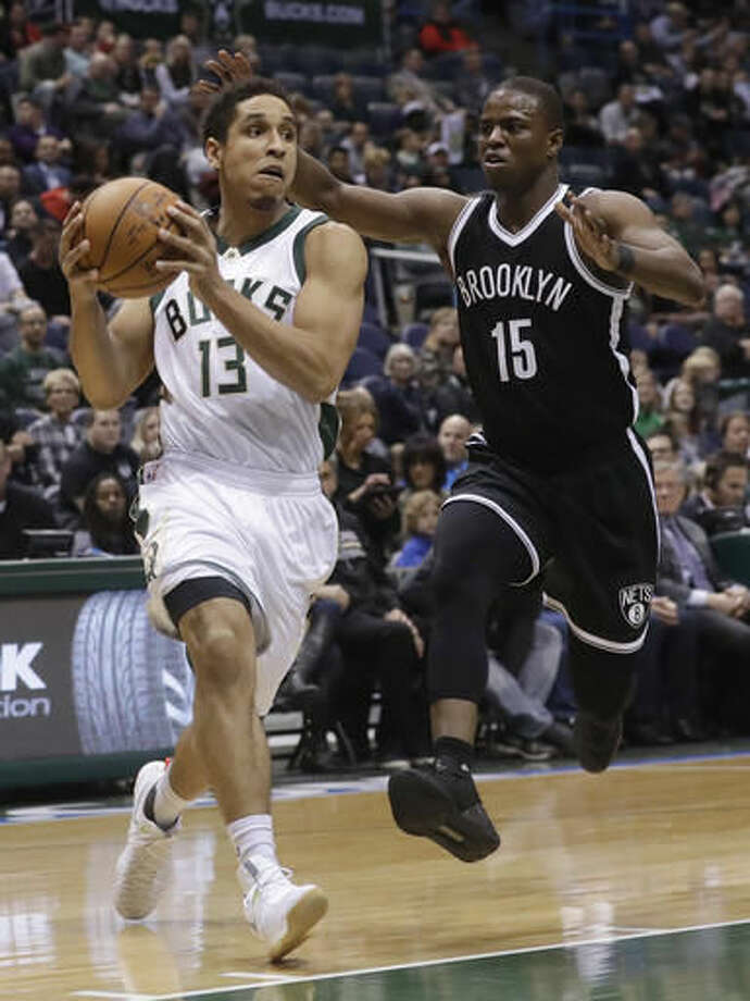 Milwaukee Bucks' Malcolm Brogdon drives past Brooklyn Nets' Isaiah Whitehead during the first half of an NBA basketball game Saturday, Dec. 3, 2016, in Milwaukee. (AP Photo/Morry Gash)