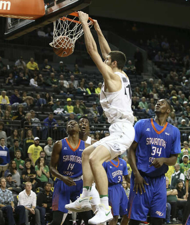 Oregon's Roman Sorkin, center, dunks against Savannah State during the second half of an NCAA college basketball game Saturday, Dec. 3, 2016, in Eugene, Ore. (AP Photo/Chris Pietsch)