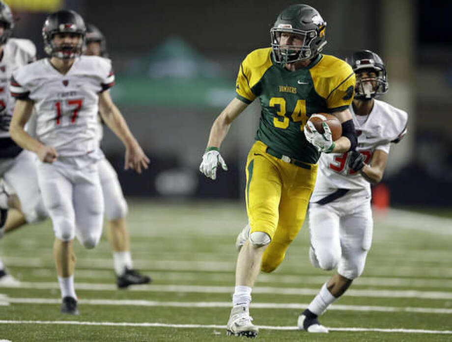 Richland running back Ben Stanfield (34) runs for a touchdown against Camas during the first half of the Washington Div. 4A high school football championship, Saturday, Dec. 3, 2016, in Tacoma, Wash. (AP Photo/Ted S. Warren)