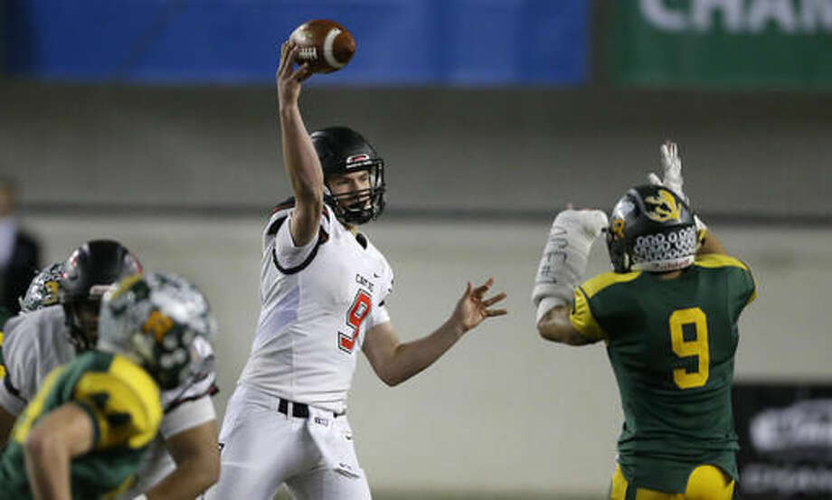 Camas quarterback Jack Colletto passes under pressure from Richland defensive back Kyle Kirby, right, in the first half of the Washington Div. 4A high school football championship, Saturday, Dec. 3, 2016, in Tacoma, Wash. (AP Photo/Ted S. Warren)