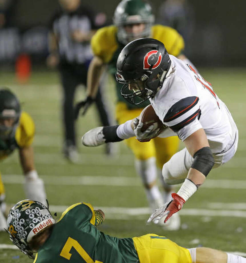 Camas' Michael Matthews gets airborne over Richland's Adam Weissenfels (7) during the first half of the Washington Div. 4A high school football championship, Saturday, Dec. 3, 2016, in Tacoma, Wash. (AP Photo/Ted S. Warren)