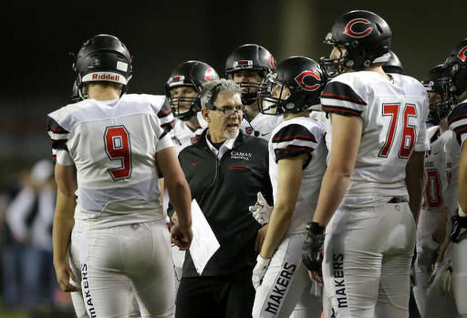 Camas coach Jon Eagle, center, talks to his players during the first half of the Washington Div. 4A high school football championship against Richland, Saturday, Dec. 3, 2016, in Tacoma, Wash. (AP Photo/Ted S. Warren)