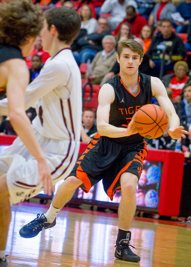 Edwardsville guard Oliver Stephen, right, brings the ball up the court and looks for an open teammate against Belleville West on Saturday at Southern Illinois.