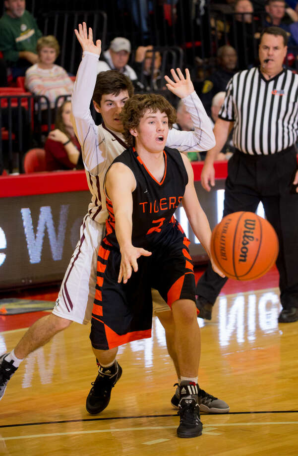 Edwardsville guard Jack Marinko, right, delivers a pass.