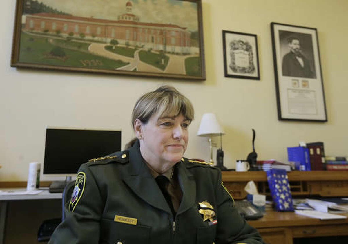 FILE - San Francisco Sheriff Vicki Hennessy is interviewed in her office after attending a meeting at City Hall in San Francisco by city leaders and community activists to reaffirm the city's commitment to being a sanctuary city in response to Donald Trump's support of deportations and other measures against immigrants Monday, Nov. 14, 2016. (AP Photo/Jeff Chiu)