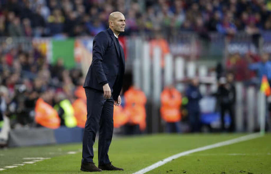 Real Madrid's head coach Zinedine Zidane looks from the sidelines during the Spanish La Liga soccer match between FC Barcelona and Real Madrid at the Camp Nou in Barcelona, Spain, Saturday, Dec. 3, 2016. (AP Photo/Manu Fernandez)