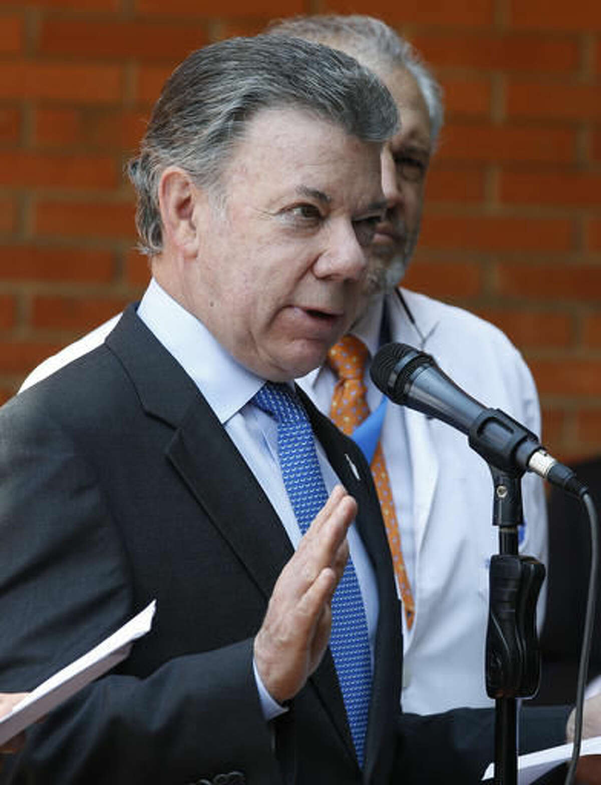 Colombia's President Juan Manuel Santos gives a press conference at the Santa Fe clinic in Bogota, Colombia, Monday, Nov. 21, 2016. Santos said he will undergo radiation to treat high levels of a prostate-specific antigen that his doctors say don't represent a return of cancer. (AP Photo/Fernando Vergara)