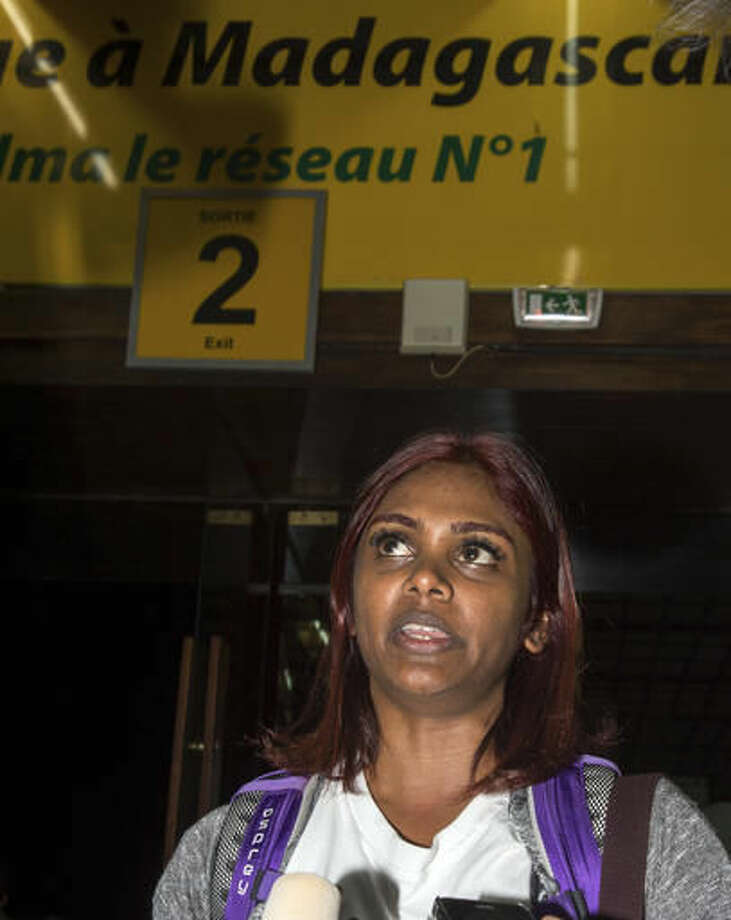 Grace Nathan, among relatives of passengers of a missing Malaysia Airlines flight MH370, address the media during their arrival at the Ivato International Airport in Antananarivo, Madagascar, Saturday, Dec. 3, 2016. Relatives of some of the 239 people who were on a Malaysia Airlines plane that vanished in 2014 have arrived in Madagascar to ask for help in the search for debris from the missing aircraft that may have drifted across the Indian Ocean. (AP Photo/Alexander Joe)