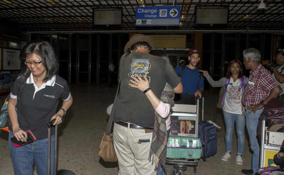 Relatives of passengers of missing Malaysian plane, arrive at the Ivato International Airport in Antananarivo, Madagascar, Saturday, Dec. 3, 2016. Relatives of some of the 239 people who were on a Malaysia Airlines plane that vanished in 2014 have arrived in Madagascar to ask for help in the search for debris from the missing aircraft that may have drifted across the Indian Ocean. (AP Photo/Alexander Joe)
