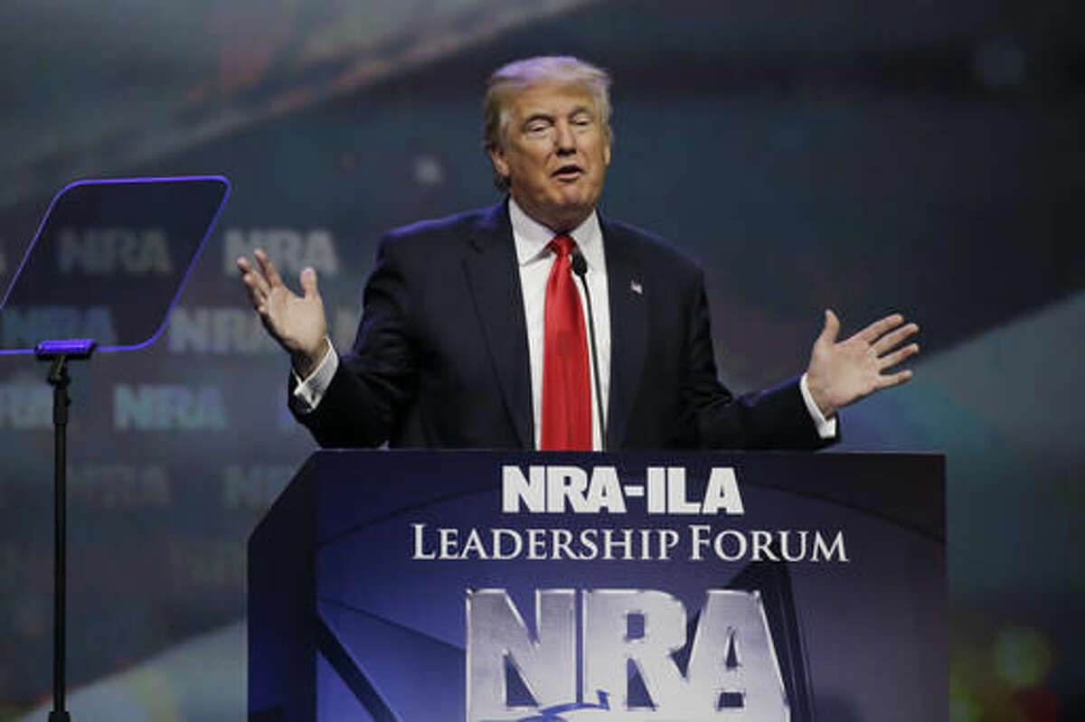 FILE - In this May 20, 2016, file photo, then-Republican presidential candidate Donald Trump speaks at the National Rifle Association (NRA) convention in Louisville, Ky. Firearms enthusiasts who embraced Donald Trump's presidential campaign and his full-throated support of the Second Amendment are expecting a sweeping expansion of gun rights under his administration and a Congress firmly controlled by Republicans. (AP Photo/Mark Humphrey, File)