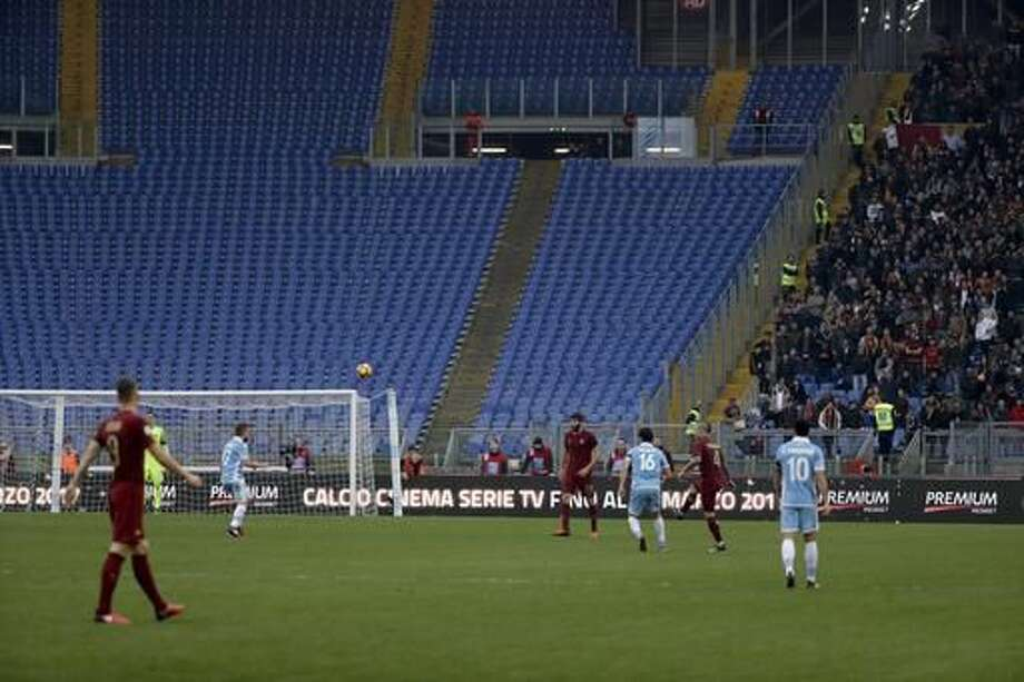 A view of a huge section of empty seats as Roma fans desert derby in protest over security barriers, during a Serie A soccer match between Lazio and Roma, at the Rome Olympic stadium Sunday, Dec. 4, 2016. (AP Photo/Gregorio Borgia)