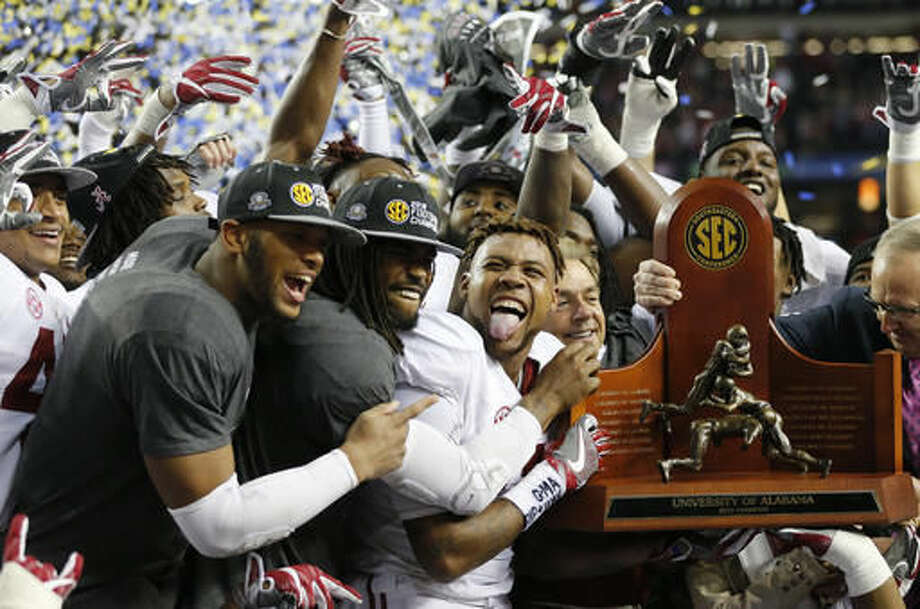 Alabama team members celebrate after the Southeastern Conference championship NCAA college football game against Florida, Saturday, Dec. 3, 2016, in Atlanta. Alabama won 54-16. (AP Photo/John Bazemore)