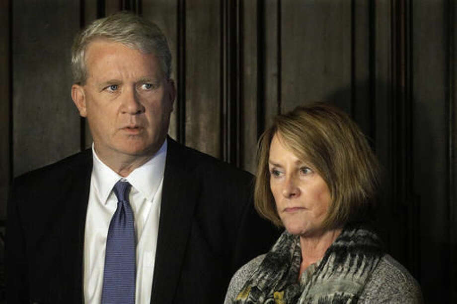 In this Tuesday, Nov. 15, 2016, photo, Illinois House Minority Leader Jim Durkin, R-Western Springs, left, and Illinois Senate Minority Leader Christine Radogno, R-Lemont, right, speak to reporters outside Illinois Gov. Bruce Rauner's office at the Illinois State Capitol in Springfield, Ill. Rauner and legislative leaders are trying to make progress on budget talks given that the current stop-gap spending measures expires in January. (AP Photo/Seth Perlman)