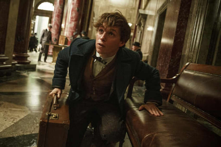 "This image released by Warner Bros. Entertainment shows Eddie Redmayne in a scene from, ""Fantastic Beasts and Where to Find Them."" (Jaap Buitendijk/Warner Bros. via AP)"