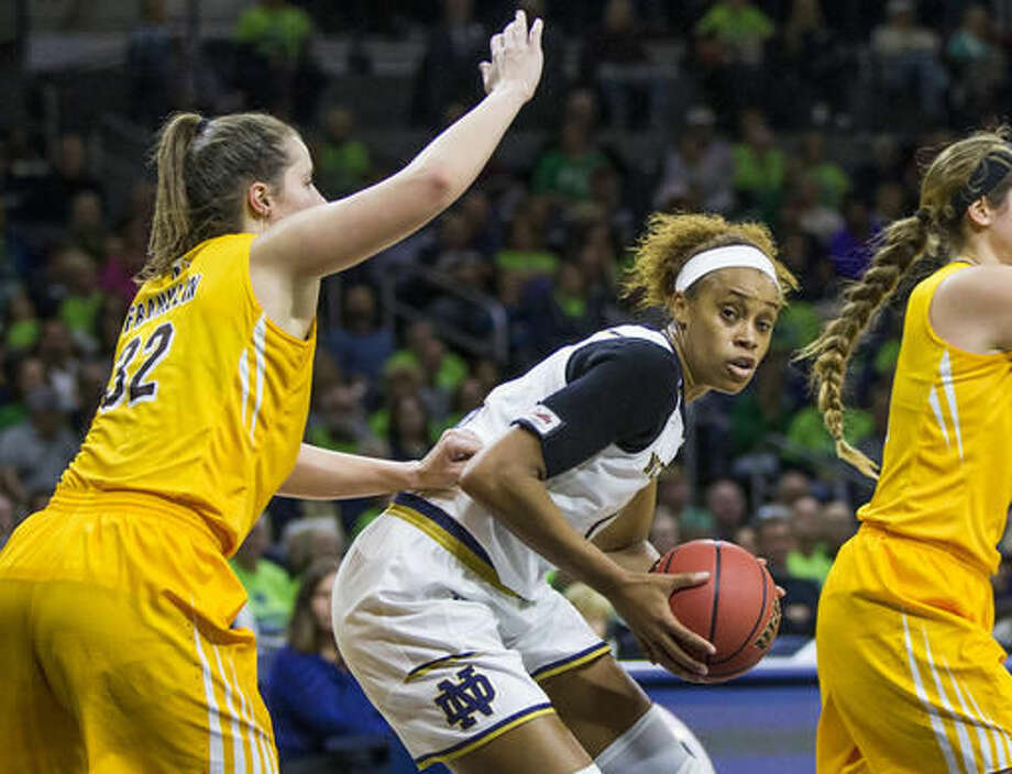 Notre Dame's Brianna Turner, center, is pressured by Valparaiso's Dani Franklin (32) during the second half of an NCAA college basketball game Sunday, Dec. 4, 2016, in South Bend, Ind. (AP Photo/Robert Franklin)