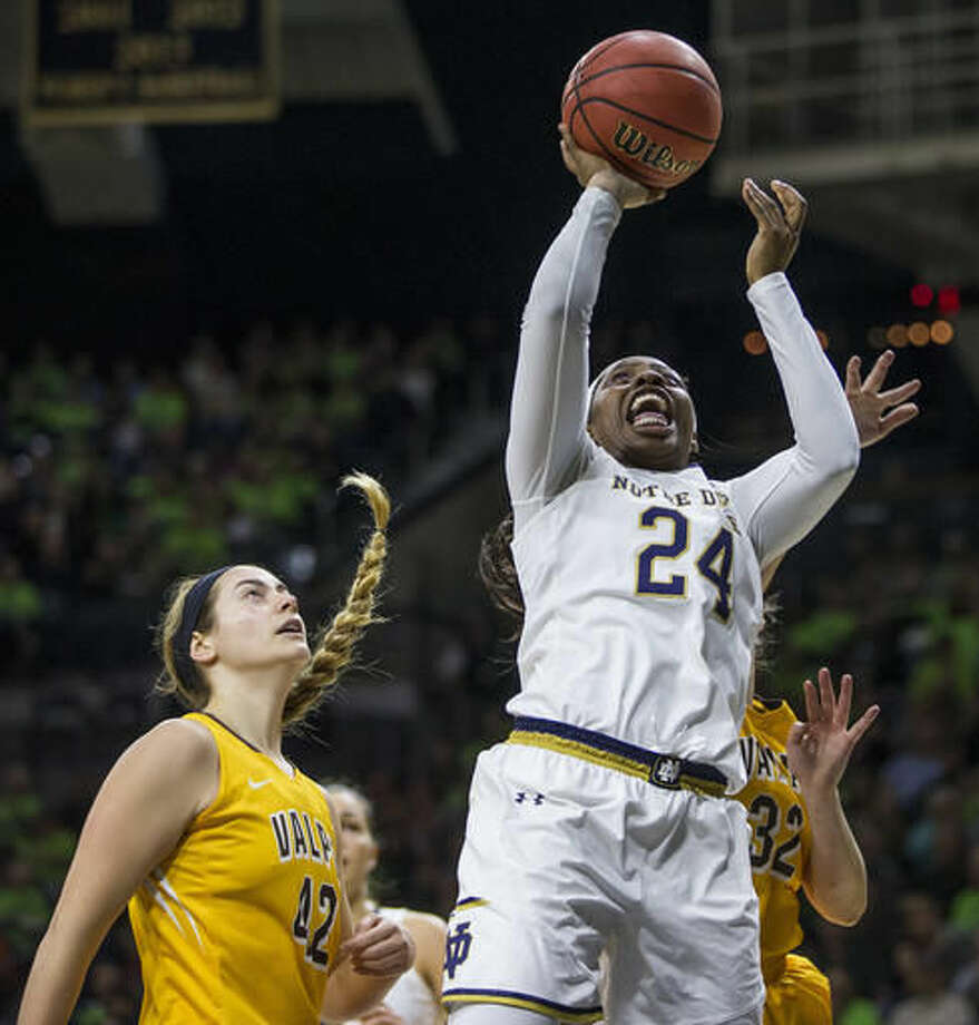 Notre Dame's Arike Ogunbowale (24) goes up to shoot over Valparaiso's Haylee Thompson (42) and Dani Franklin (32) during the first half of an NCAA college basketball game Sunday, Dec. 4, 2016, in South Bend, Ind. (AP Photo/Robert Franklin)