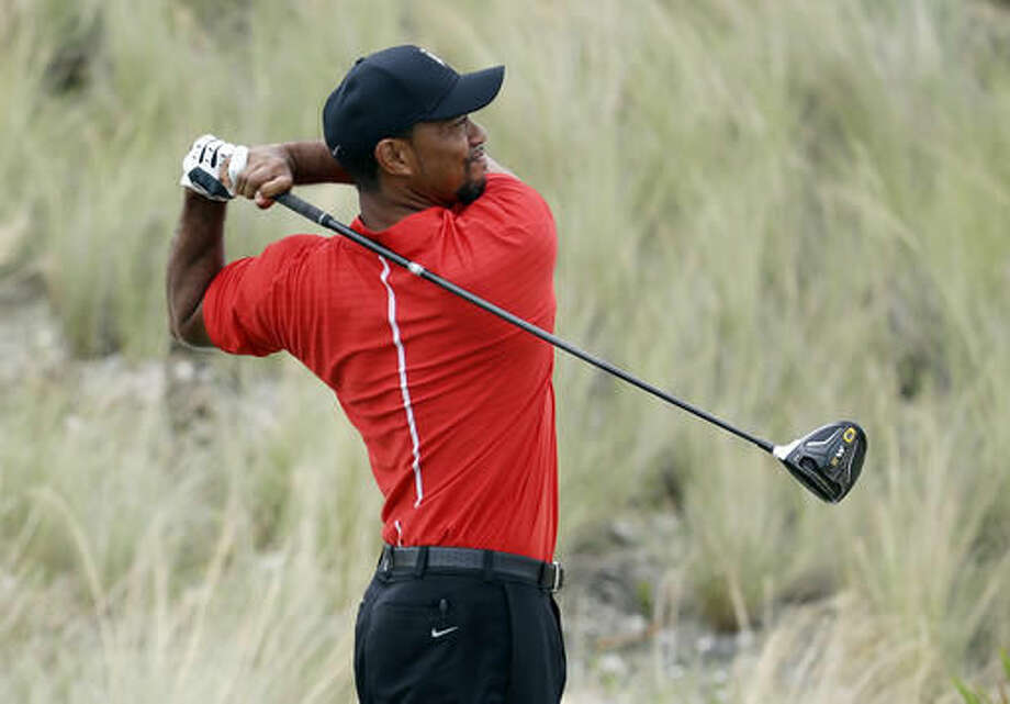 Tiger Woods watches his tee shot from the third hole during the final round at the Hero World Challenge golf tournament, Sunday, Dec. 4, 2016, in Nassau, Bahamas. (AP Photo/Lynne Sladky)