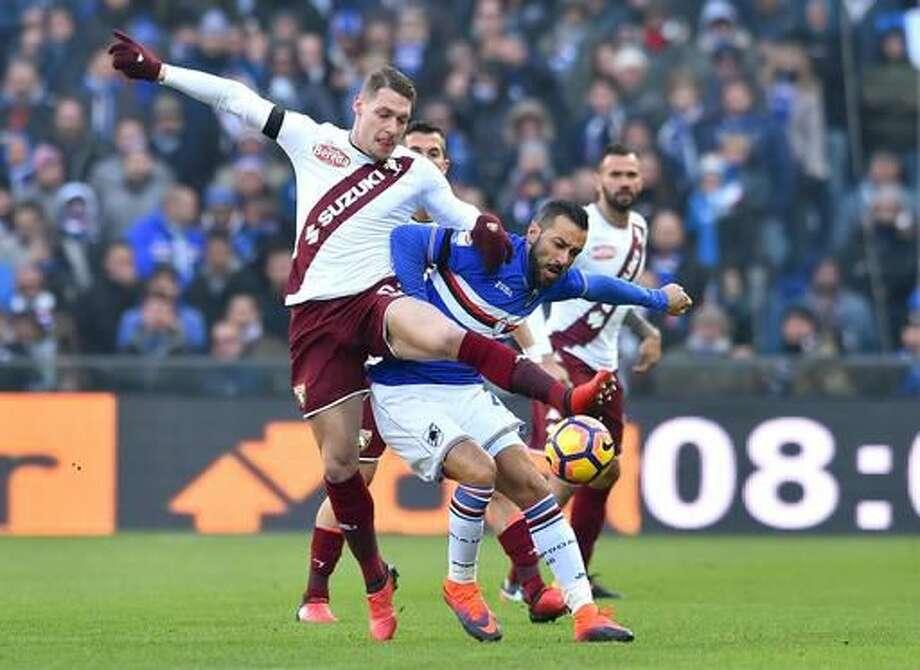 Torino's Andrea Belotti, left, challenges Sampdoria's Fabio Quagliarella during a Serie A soccer match at the Luigi Ferraris stadium in Genoa, Italy, Sunday, Dec. 4, 2016. (Simone Arveda/ANSA via AP)