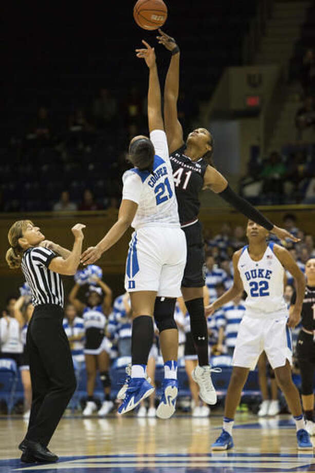Duke's Kendall Cooper (21) and South Carolina's Alaina Coates (41) tip-off at the start of an NCAA college basketball game in Durham, N.C., Sunday, Dec. 4, 2016. (AP Photo/Ben McKeown)