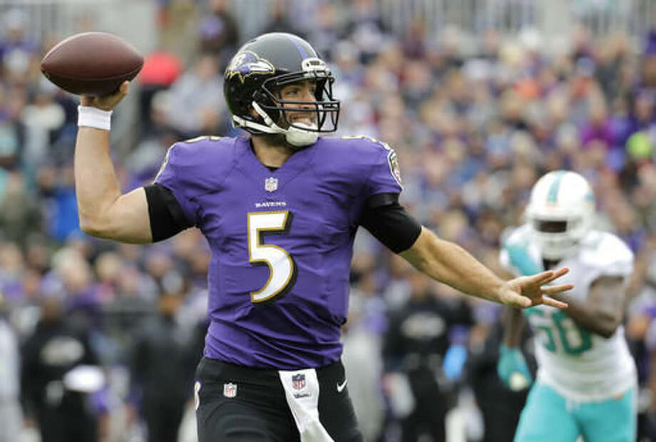 Baltimore Ravens quarterback Joe Flacco throws to a receiver in the first half of an NFL football game against the Miami Dolphins, Sunday, Dec. 4, 2016, in Baltimore. (AP Photo/Patrick Semansky)