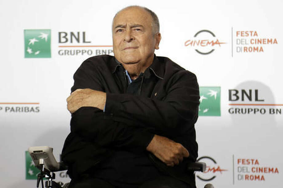 "FILE - In this Oct. 15, 2016, file photo, director Bernardo Bertolucci poses for photographers during a photo call at the Rome Film festival in Rome. A recently unearthed video interview with Bertolucci from 2013 has renewed interest, and outrage, over what happened to actress Maria Schneider on set during the infamous butter sex scene in ""Last Tango in Paris"". (AP Photo/Gregorio Borgia, File)"