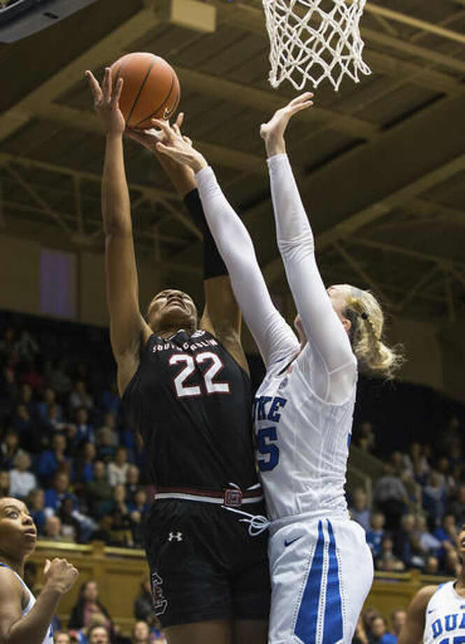 South Carolina's A'ja Wilson (22) attempts a shot as Duke's Erin Mathias, right, defends during the first hafl of an NCAA college basketball game in Durham, N.C., Sunday, Dec. 4, 2016. (AP Photo/Ben McKeown)