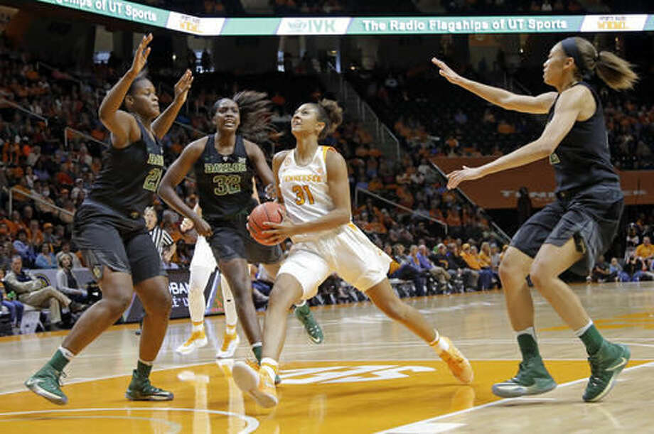Tennessee's Jaime Nared (31) drives against Baylor's Kalani Brown (21), Beatrice Mompremier (32) and Alexis Prince, right, in the first half of an NCAA college basketball game Sunday, Dec. 4, 2016, in Knoxville, Tenn. (AP Photo/Mark Humphrey)