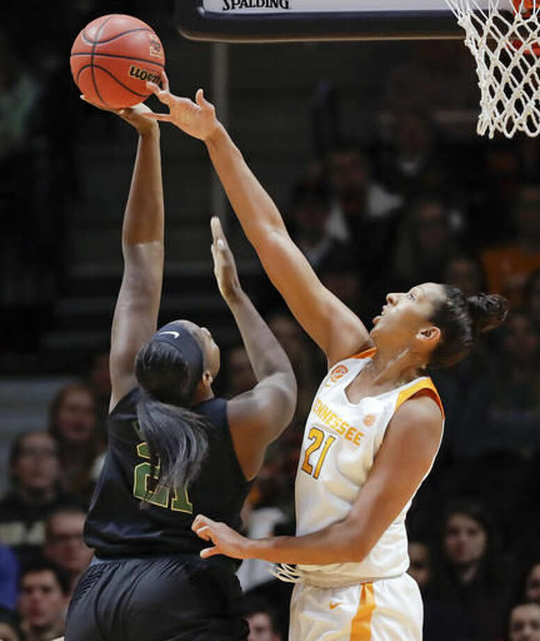 Tennessee center Mercedes Russell, right, blocks a shot by Baylor center Kalani Brown, left, in the first half of an NCAA college basketball game, Sunday, Dec. 4, 2016, in Knoxville, Tenn. (AP Photo/Mark Humphrey)