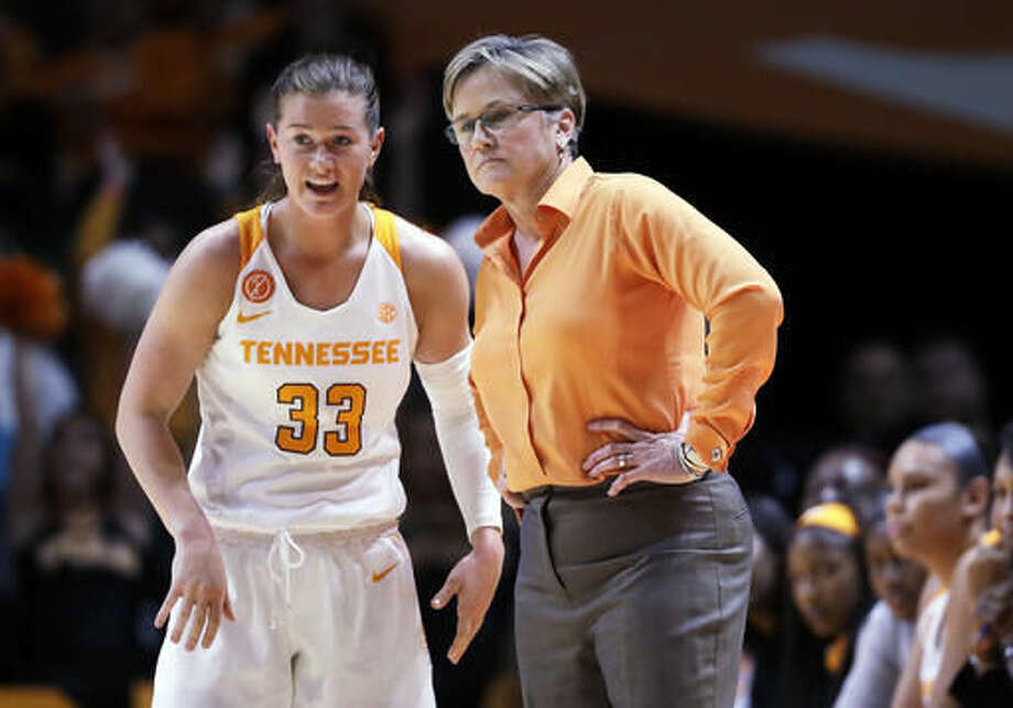 Tennessee head coach Holly Warlick talks with guard Alexa Middleton (33) in the first half of an NCAA college basketball game against Baylor Sunday, Dec. 4, 2016, in Knoxville, Tenn. (AP Photo/Mark Humphrey)