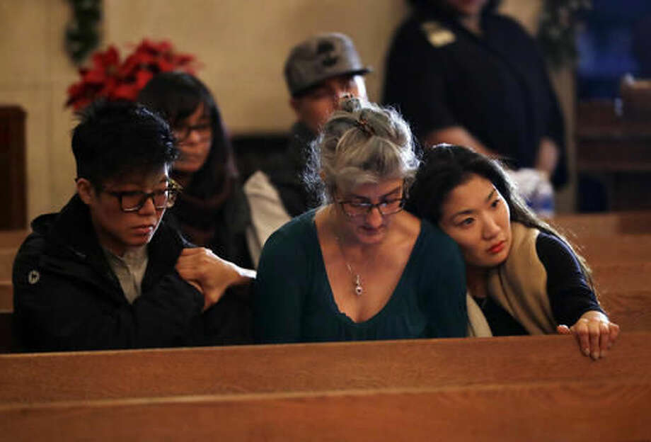 Attendees embrace during a memorial for victims of a warehouse fire at Chapel of the Chimes Saturday, Dec. 3, 2016, in Oakland, Calif. Firefighters struggled to get to bodies in the rubble Saturday after a deadly fire tore through a converted Oakland warehouse during a late-night electronic music party Friday, making the charred structure unsafe for emergency crews to enter. (AP Photo/Marcio Jose Sanchez)