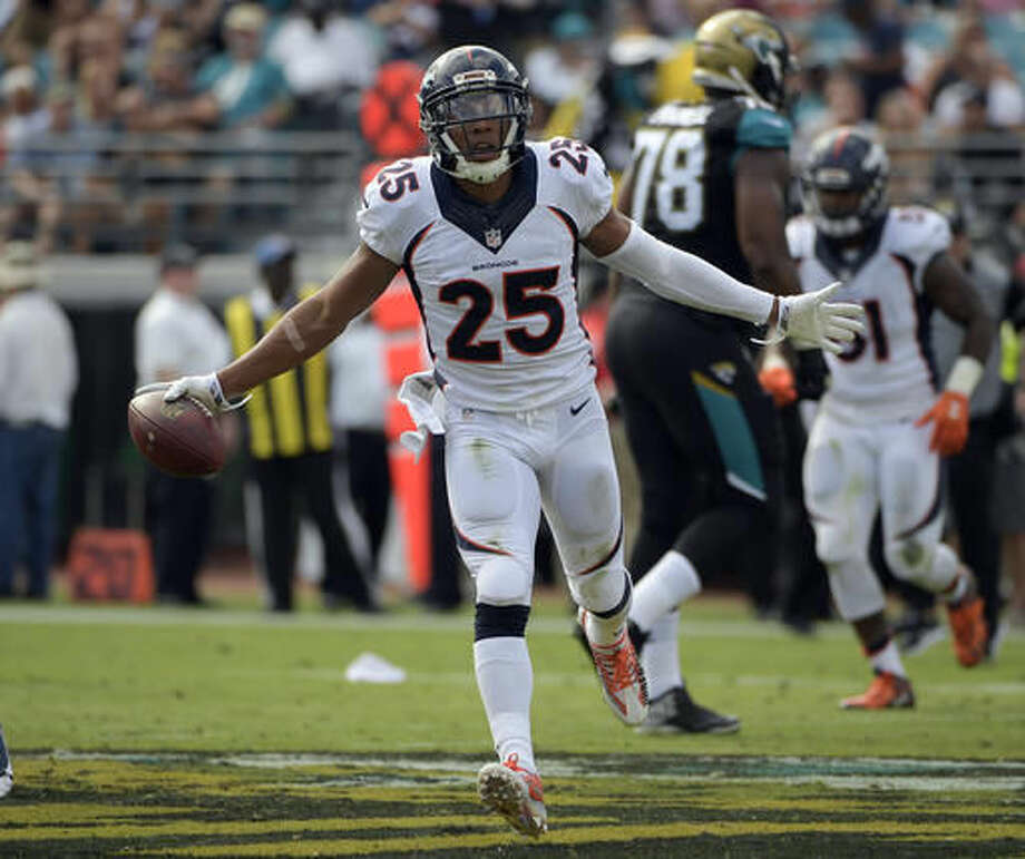 Denver Broncos cornerback Chris Harris (25) celebrates after intercepting a pass against the Jacksonville Jaguars during the first half of an NFL football game in Jacksonville, Fla., Sunday, Dec. 4, 2016. (AP Photo/Phelan M. Ebenhack)