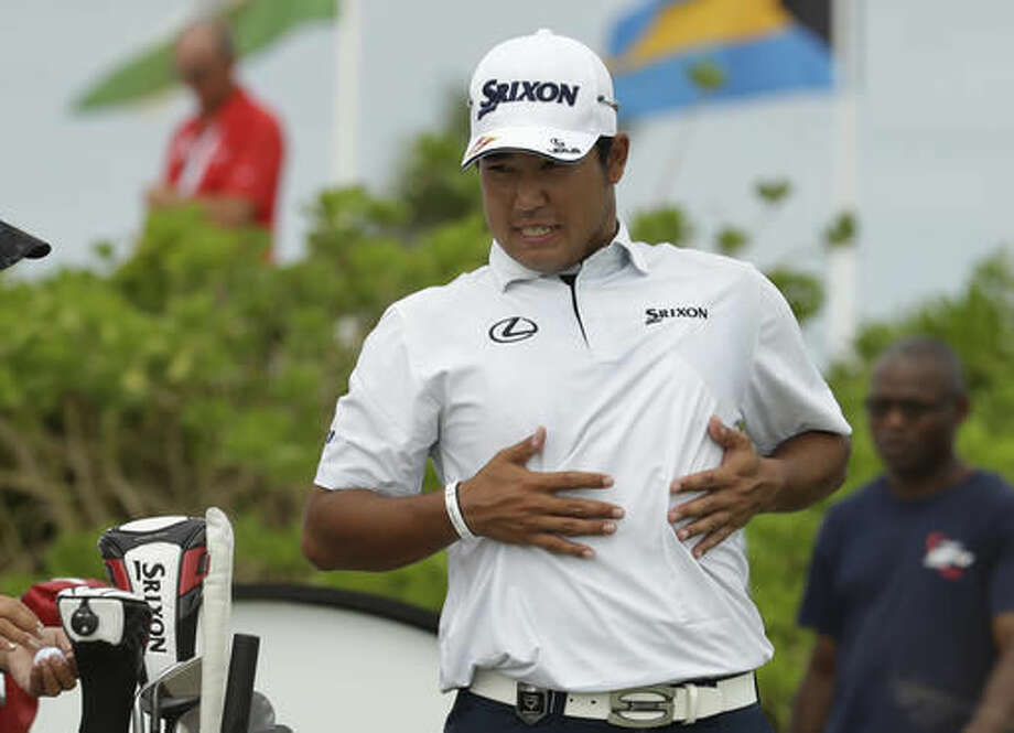 Hideki Matsuyama, of Japan, stretches before teeing off on the first hole during the final round at the Hero World Challenge golf tournament, Sunday, Dec. 4, 2016, in Nassau, Bahamas. (AP Photo/Lynne Sladky)