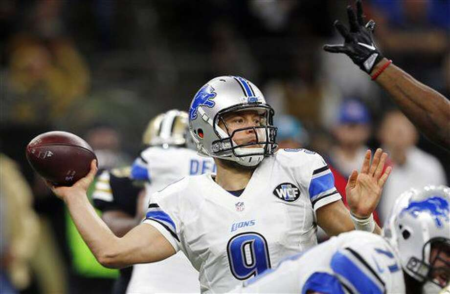Detroit Lions quarterback Matthew Stafford (9) throws a touchdown pass to wide receiver Golden Tate, not pictured, in the second half of an NFL football game in New Orleans, Sunday, Dec. 4, 2016. (AP Photo/Butch Dill)