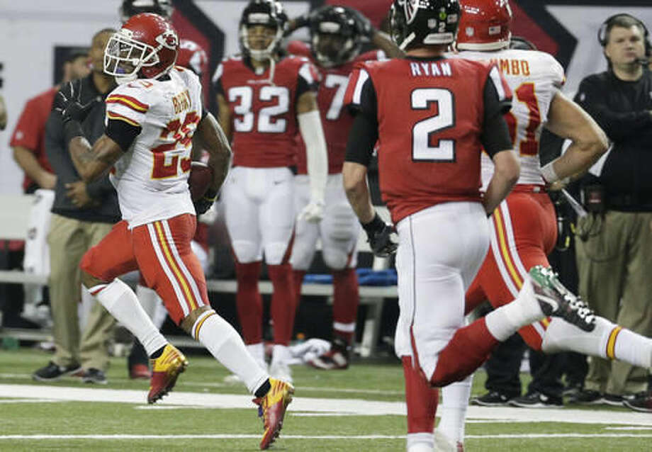 Kansas City Chiefs strong safety Eric Berry (29) runs back an intercepted ball from a Atlanta Falcons two-point conversion during the second half of an NFL football game, Sunday, Dec. 4, 2016, in Atlanta. (AP Photo/Chuck Burton)