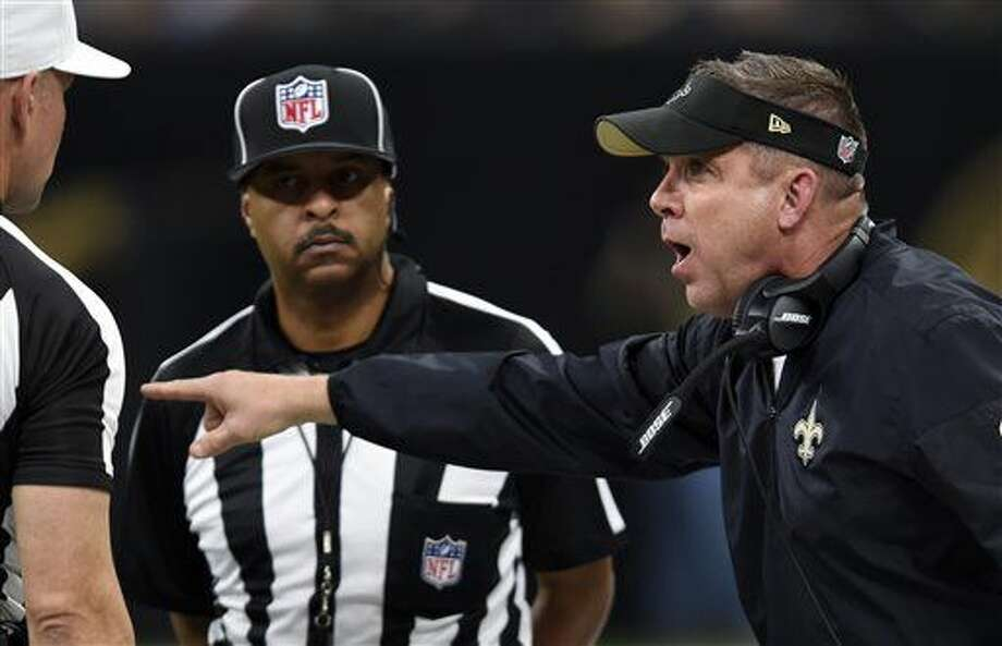 New Orleans Saints head coach Sean Payton challenges the officials in the first half of an NFL football game against the Detroit Lions in New Orleans, Sunday, Dec. 4, 2016. (AP Photo/Bill Feig)