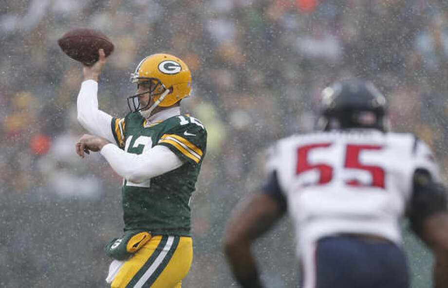 Green Bay Packers' Aaron Rodgers throws during the first half of an NFL football game against the Houston Texans Sunday, Dec. 4, 2016, in Green Bay, Wis. (AP Photo/Matt Ludtke)