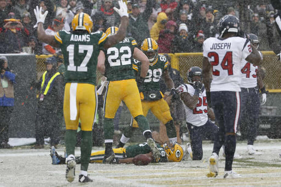 Green Bay Packers' Randall Cobb does a snow angel after catching a touchdown pass during the first half of an NFL football game against the Houston Texans Sunday, Dec. 4, 2016, in Green Bay, Wis. (AP Photo/Mike Roemer)