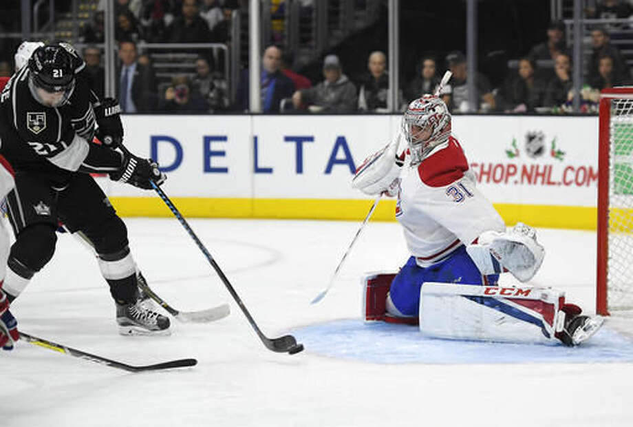 Los Angeles Kings center Nick Shore, left, scores on Montreal Canadiens goalie Carey Price during the second period of an NHL hockey game, Sunday, Dec. 4, 2016, in Los Angeles. (AP Photo/Mark J. Terrill)