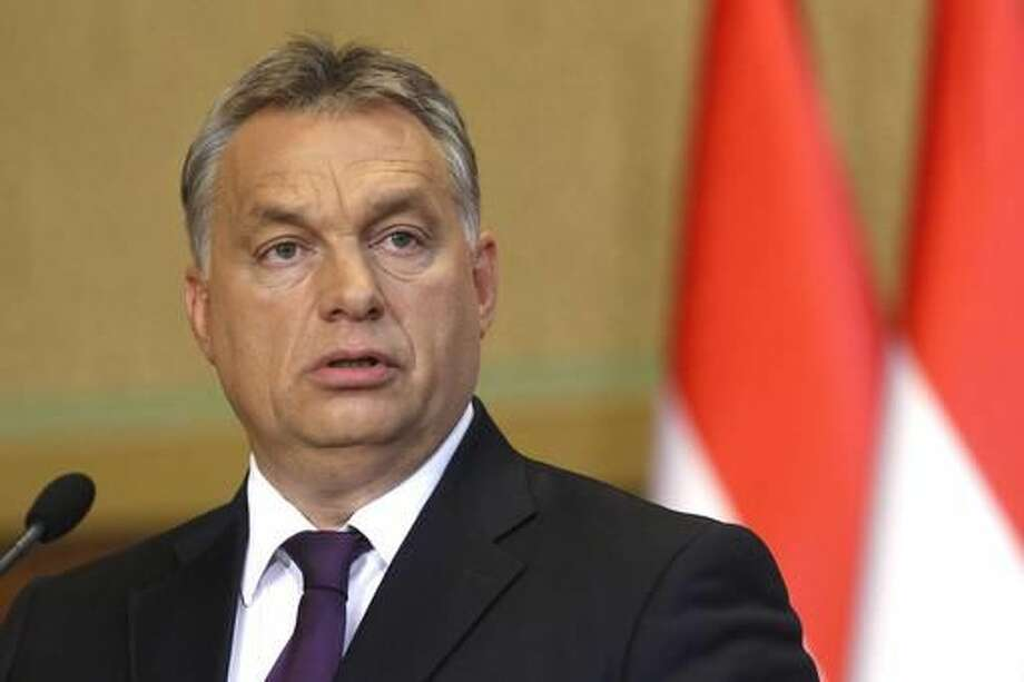 FILE - In this Oct. 4, 2016 file photo Hungarian Prime Minister Viktor Orban speaks during a press conference concerning the referendum on migrants held in Hungary on the European Commission's proposed mandatory resettlement of migrants in member states of EU. Orban's Fidesz party failed Tuesday, Nov. 8, 2016 to secure any opposition support and fell two votes short of the two-thirds majority necessary in today's vote. (Zsolt Szigetvary/MTI via AP, file)