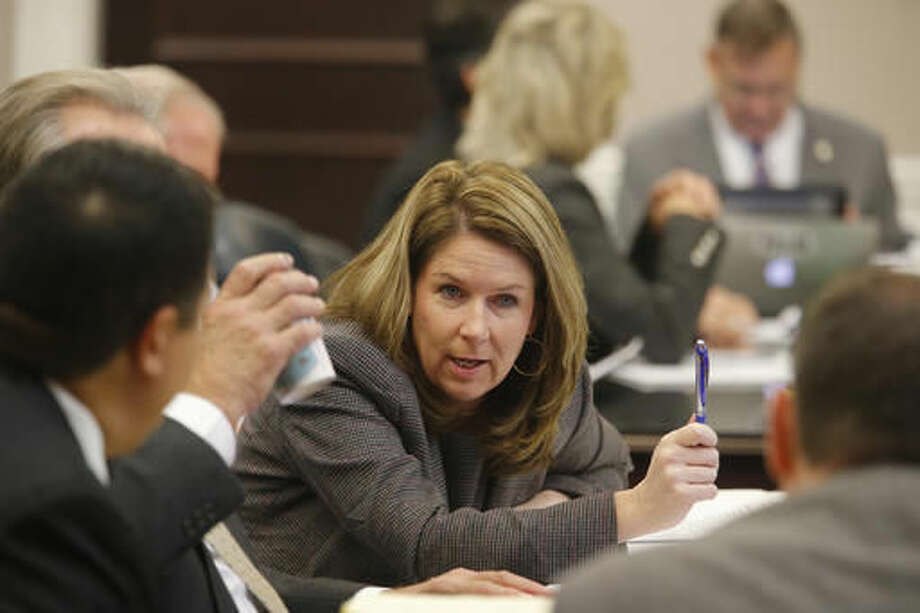 Ninth Circuit Solicitor Scarlett Wilson, speaks with lawyers during the murder trial of former North Charleston Police Officer Michael Slager, Monday, Nov. 7, 2016, in Charleston, S.C. Slager is on trial facing a murder charge in the shooting death of Walter Scott, who was gunned down after he fled from a traffic stop. (Grace Beahm/Post and Courier via AP, Pool)