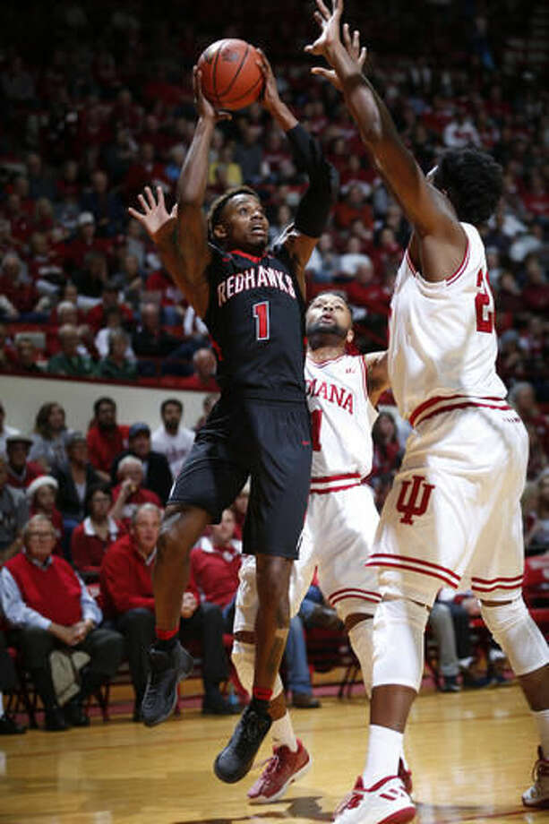 Southeast Missouri guard Antonius Cleveland (1) shoots between Indiana defenders James Blackmon Jr. (1) and De'Ron Davis (20) in the first half of an NCAA college basketball game in Bloomington, Ind., Sunday, Dec. 4, 2016. (AP Photo/AJ Mast)