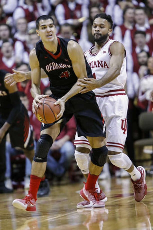 Southeast Missouri forward Milos Vranes, left, tries to keep the ball away from Indiana guard James Blackmon Jr. in the first half of an NCAA college basketball game in Bloomington, Ind., Sunday, Dec. 4, 2016. (AP Photo/AJ Mast)