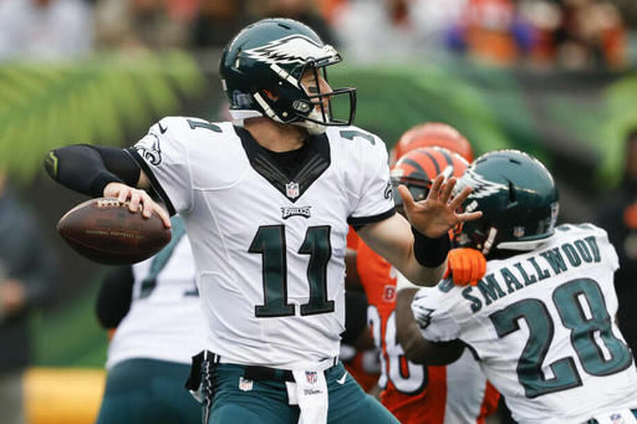 Philadelphia Eagles quarterback Carson Wentz passes in the first half of an NFL football game against the Cincinnati Bengals, Sunday, Dec. 4, 2016, in Cincinnati. (AP Photo/Gary Landers)