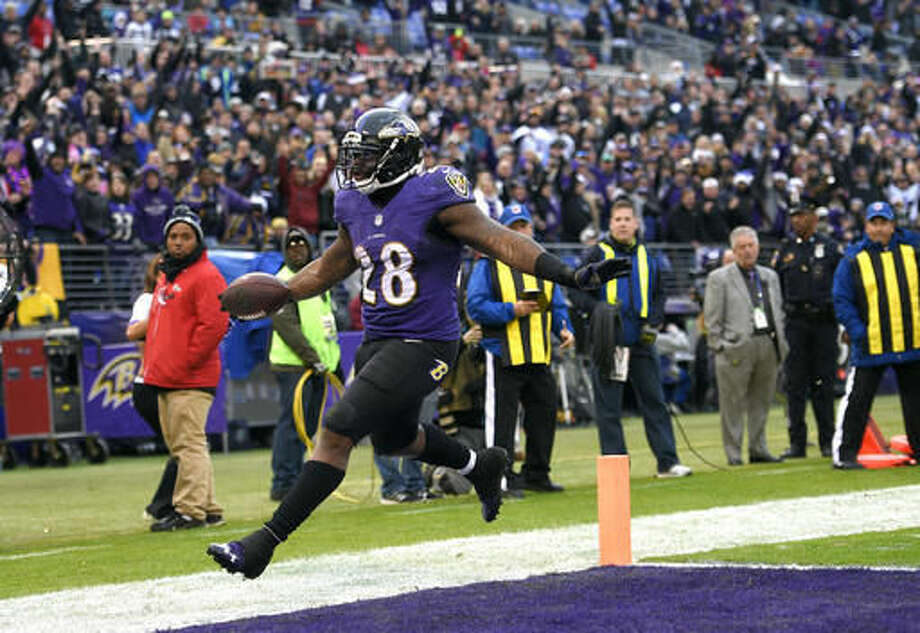Baltimore Ravens running back Terrance West scores a touchdown in the second half of an NFL football game against the Miami Dolphins, Sunday, Dec. 4, 2016, in Baltimore. (AP Photo/Nick Wass)