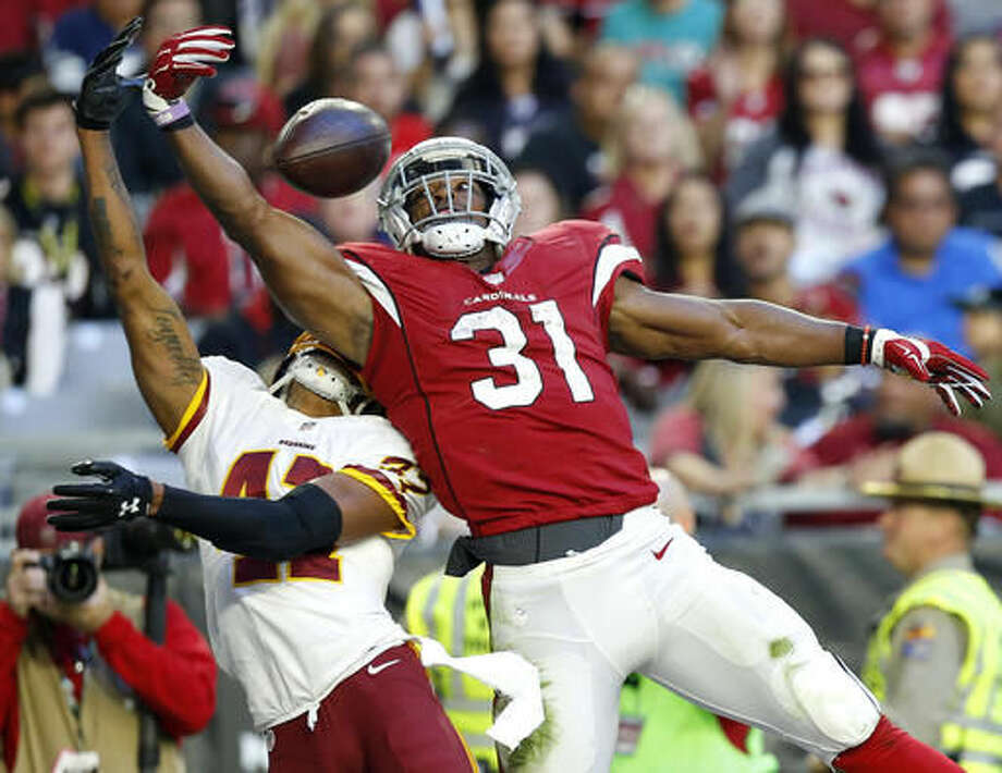 Arizona Cardinals running back David Johnson (31) can't make the catch as Washington Redskins free safety Will Blackmon (41) defends during the second half of an NFL football game, Sunday, Dec. 4, 2016, in Glendale, Ariz. (AP Photo/Ross D. Franklin)