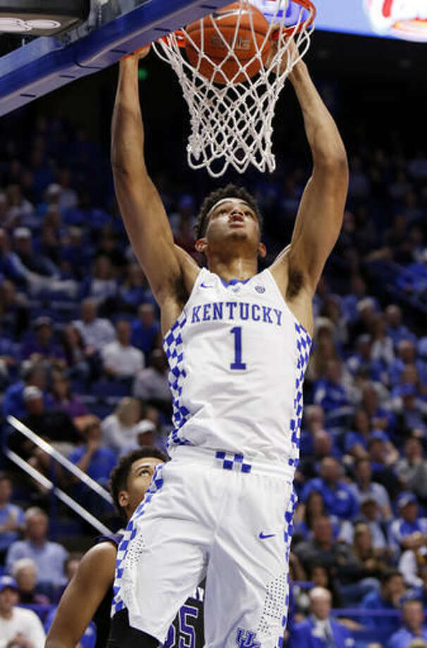 FILE - In this Nov. 6, 2016, file photo, Kentucky's Sacha Killeya-Jones (1) dunks near Asbury's Jordan Houston during the second half of an NCAA college basketball exhibition game, in Lexington, Ky. Kentucky's John Calipari landed five of the nation's top 24 prospects according to composite rankings of recruiting websites compiled by 247Sports. The new Wildcats include guards De'Aaron Fox, Malik Monk, Bam Adebayo, Wenyen Gabriel and Sacha Killeya-Jones. (AP Photo/James Crisp, File)