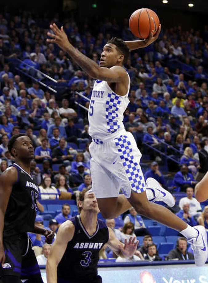 FILE - In this Nov. 6, 2016, file photo, Kentucky's Malik Monk, right, dunks near Asbury's Bushe Ramabu, left, and Daulton Peters during the second half of an NCAA college basketball exhibition game, in Lexington, Ky. Kentucky's John Calipari landed five of the nation's top 24 prospects according to composite rankings of recruiting websites compiled by 247Sports. The new Wildcats include guards De'Aaron Fox, Malik Monk, Bam Adebayo, Wenyen Gabriel and Sacha Killeya-Jones. (AP Photo/James Crisp, File)