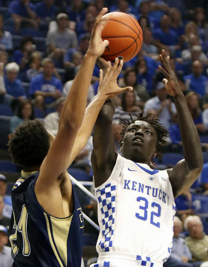 FILE - In this Oct. 30, 2016, file photo, Kentucky's Wenyen Gabriel (32) shoots while pressured by Clarion's Justin Grant during the first half of their NCAA college basketball exhibition, in Lexington, Ky. Kentucky's John Calipari landed five of the nation's top 24 prospects according to composite rankings of recruiting websites compiled by 247Sports. The new Wildcats include guards De'Aaron Fox, Malik Monk, Bam Adebayo, Wenyen Gabriel and Sacha Killeya-Jones. (AP Photo/James Crisp, File)