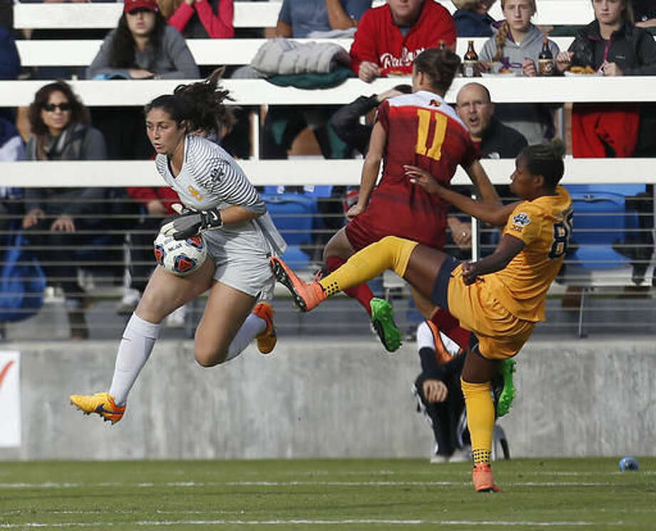Southern California's goalkeeper Sammy Jo Prudhomme, left, blocks a shot by West Virginia's Kadeisha Buchanan, right, during the first half in the NCAA Women's College Cup soccer final, Sunday, Dec. 4, 2016 in San Jose, Calif. (AP Photo/Tony Avelar)
