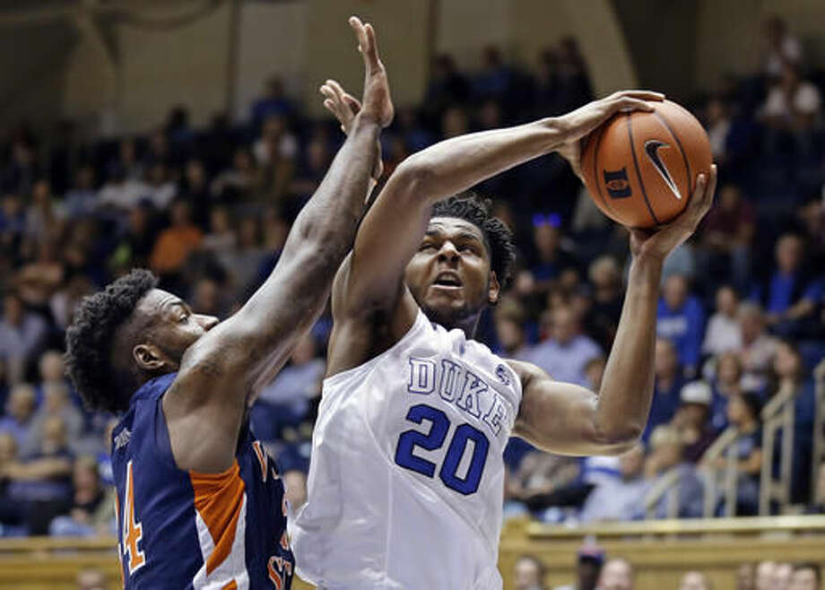 FILE - In this Oct. 28, 2016, file photo, Duke's Marques Bolden (20) is pressured by Virginia State's Amiel Terry during the first half of an exhibition NCAA college basketball game in Durham, N.C. Duke's six-man freshman class has four of the nation's top 15 recruits according to composite rankings of recruiting websites compiled by 247Sports. That group includes forwards Harry Giles (No. 2) and Jayson Tatum (No. 4), guard Frank Jackson (No. 13) and center Marques Bolden (No. 15). (AP Photo/Gerry Broome, File)
